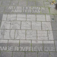 Sidewalk advertisement, made with stencil and cleaning fluid.