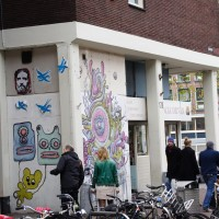 Graffiti evolution on an ice cream shop.