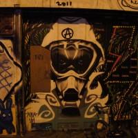 Random multi-panel street art on a wall of a sqatter house on Spuistraat