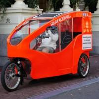 Solar bike rikshaw in front of the Amstel Hotel.