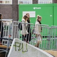 Pedestrian bridge and construction at the Amsterdam University demolition site.