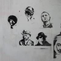 Stencil street art on a wall in an abandoned tram center.