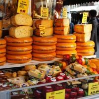 Cheese vendor at Tenkatemarkt street market.