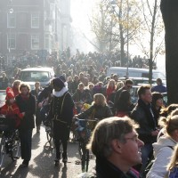 Procession following Sinterklaas's ship along the Amstel river