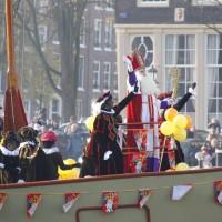 Sinterklaas and Zwarte Pieten arriving in Amsterdam from Spain on their steamboat.