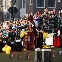 Sinterklaas waving to the crowd as his steamboat passes through the Skinny bridge