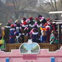 Zwarte Pieten on another steamship following Sinterklaas through Amsterdam