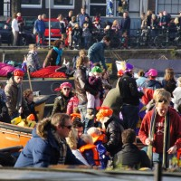 Chaos on the Amstel. Procession of boats following the steamboat of Sinterklaas