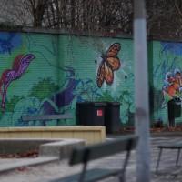 Graffiti on a wall of a playground