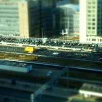 Miniature cars and trucks on the motorway at Station Zuid Amsterdam