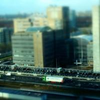 Miniature trucks on the motorway at Station Zuid Amsterdam