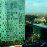 Miniature truck on the motorway and World Trace Center at Station Zuid Amsterdam