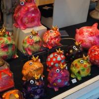 Froggy banks in a shop window
