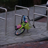 Lock it or loose it. Kids learn early here. Two massive chain locks that weigh more than the bike, probably cost more too.