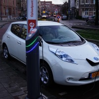 Electric Nissan plugged into a free charging point