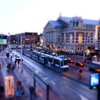 Busy miniature trams on Van Baerlestraat in front of the Concertgebouw