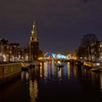 The Montelbaanstoren on the Oudeschans and Nemo behind it from the St. Antoniesluis bridge