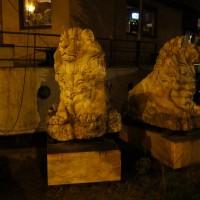 Two random stone lions outside a houseboat.