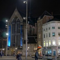 "North-west side of the Dam Plaza and the ""Nieuwe Kerk"", the new church (with blue lights)"