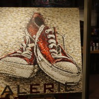 Sneakers in a gallery.