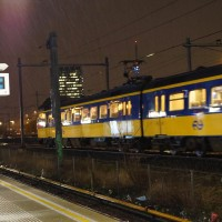 Inter-city train arriving from the east, heading west to Schiphol Airport