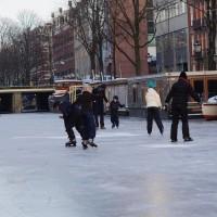 Neighbors skating on the Nieuwe Prinsengracht