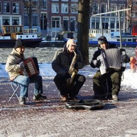 Extremely emotional and sad music in front of a sunken houseboat near the Waterlooplein