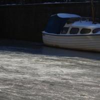 Skate tracks on well-used ice.