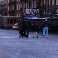 Beautiful moment of a family of skating together.