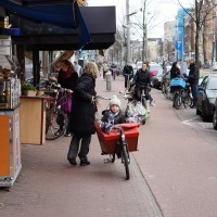 Box bike, bakfiets, with kid and flowers