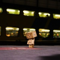 Danbo is making sure she's standing on the right Thalys spot as a train goes past.