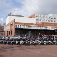 Every parking enforcement scooter in Amsterdam rallied at Stopera