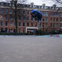 Roller-blader flying out of the skate pool