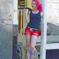 Rosanna the tattoo artist in her shop doorway