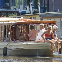 People enjoying a Saloon boat ride