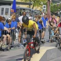 Kids taking turns trying BMX