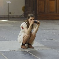 Beautiful girl getting a shot at the World Press Photo exhibit in the Oudekerk