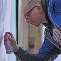 "Ben 'EINE"" painting a huge wall"