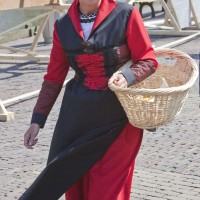 Beautiful woman in costume at the cheese market