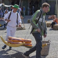 Men racing with cheese at the market in Alkmaar