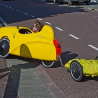 Electric bicycle car with a trailer.