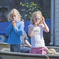 Very cute Dutch kids on a boat