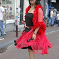 7-foot tall drag queen carefully navigating the cobbled streets