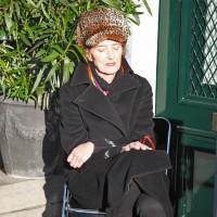 Elegant lady enjoying the warmth of late November sun.